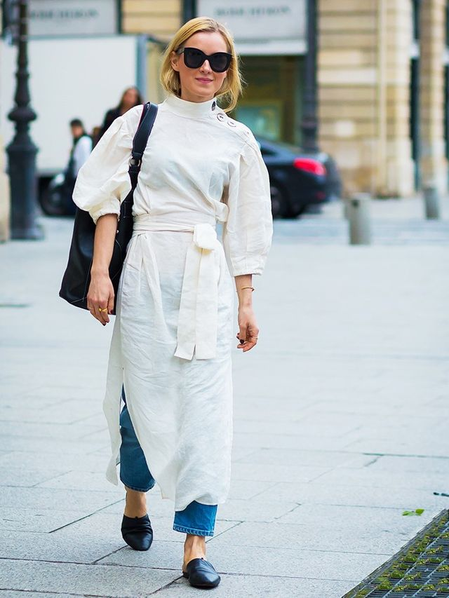 Style Notes: Perhaps you're less of a button-down girl but still want to get in on this layered look. Then opt for something billowing and romantic, ground it with sawn-off denim and black...