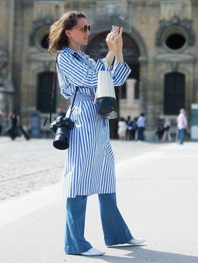 Style Notes: Street style photographer Sandra Semburg got the memo: Her striped Céline shirt dress perfectly matches the blue of her jeans and the white of her Nicholas Kirkwood...