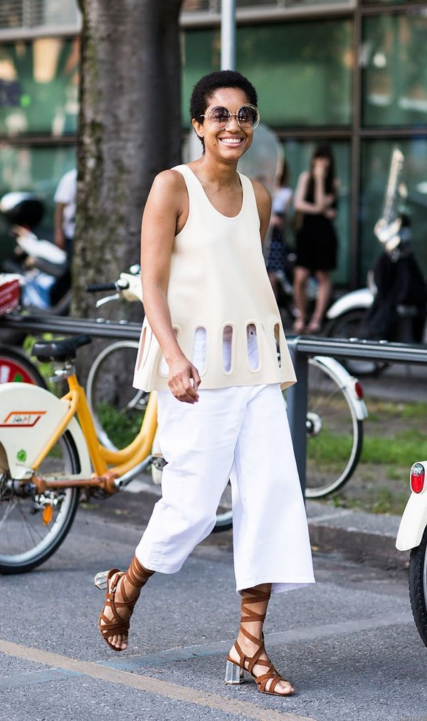 Tamu McPherson wearing all white and lace up sandals