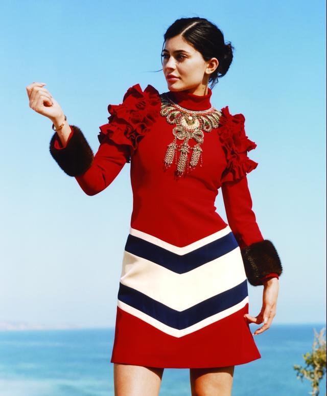 On Kylie Jenner: Gucci dress and Cartier bracelet.