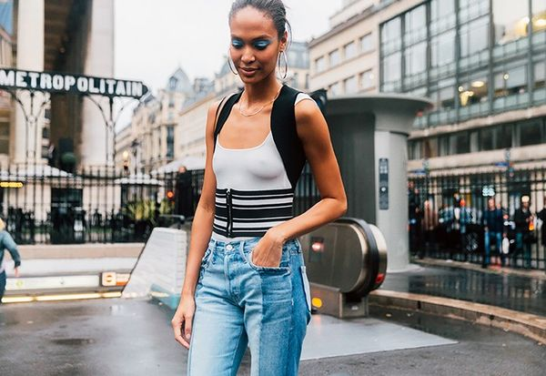Joan Smalls added a sporty element to herlook with a striped corset-style belt.