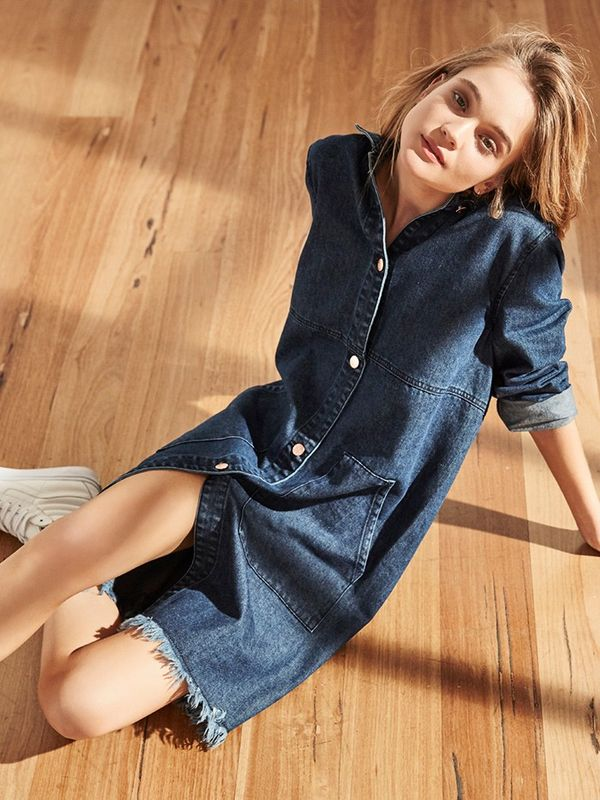 Accessorize a button-down denim dress with white sneakers.