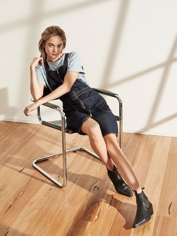 Tame an alluring front-zip dress with a worn-in top and Chelsea boots.