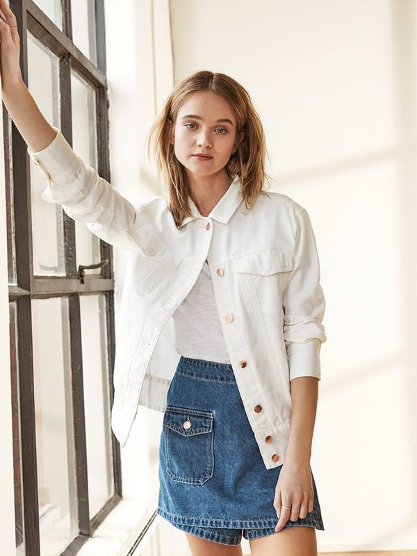 Style a white denim jacket with a bright blue miniskirt.
