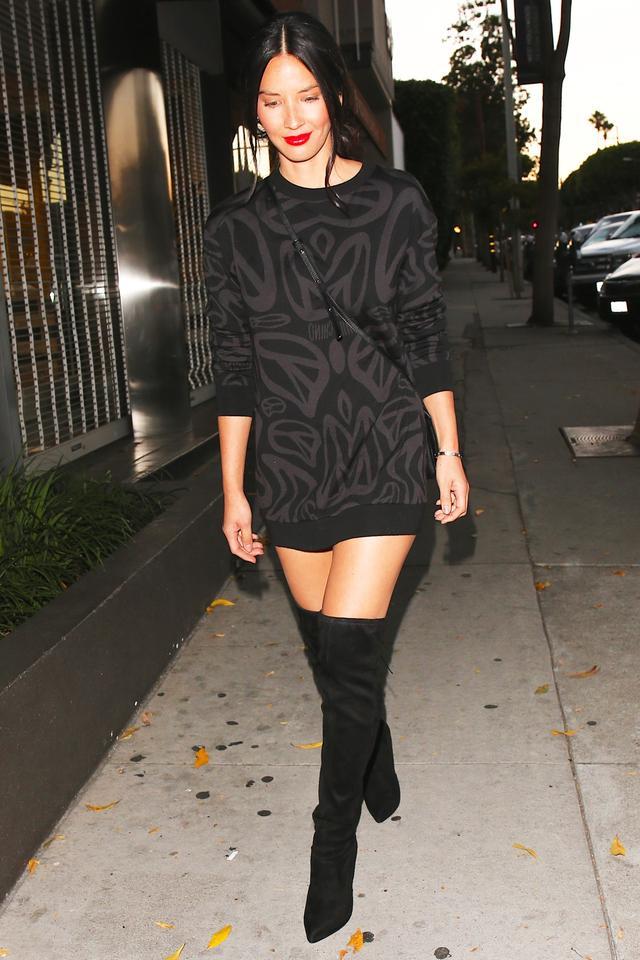 Olivia Munn lamp shading Christian Louboutin over-the-knee boots