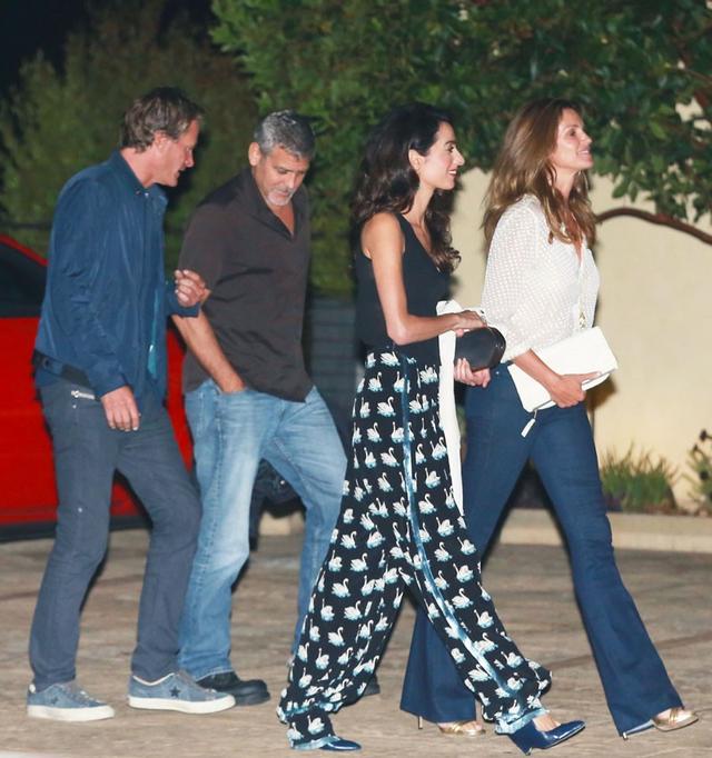 On Amal Clooney: Stella McCartneySwan Print Rosetta Trousers($1895); Akola Projectearrings. On Cindy Crawford: McGuireMajorelle Flare Jeans($169).