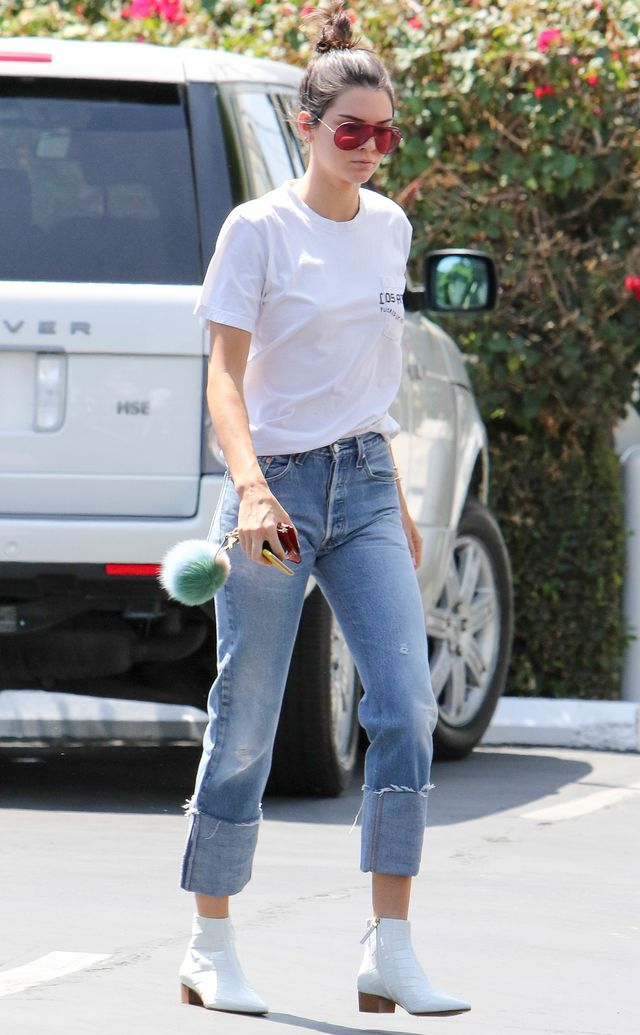 On Kendall Jenner: Re/Done The High Rise Straight Cuff Jeans ($295); The Row Ambra Glossed Alligator Ankle Boots ($7500).