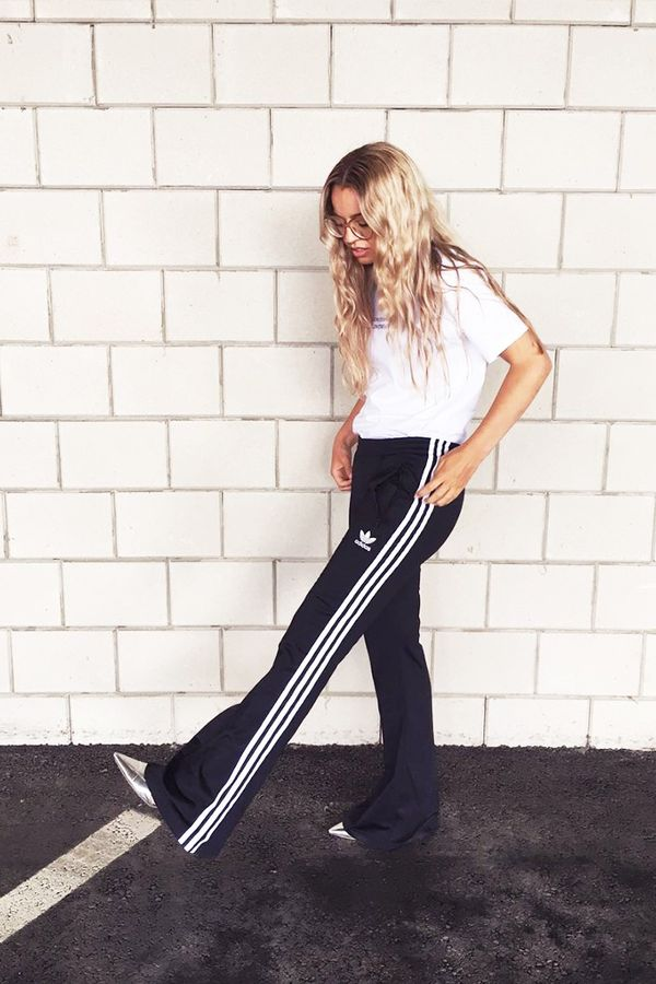 On Stephanie Broek:Adidas Originals Three Stripe Wide Leg Trousers($77); Grind London T-shirt.