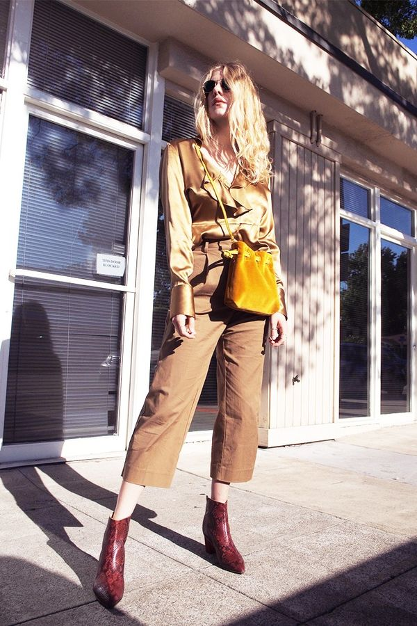 On Taylr Anne: Vintage blouse; Everlane The Twill Crop Pant($78); Clare V. Henri Purse ($245); ATP Atelier Bianca Rust Boots($417).