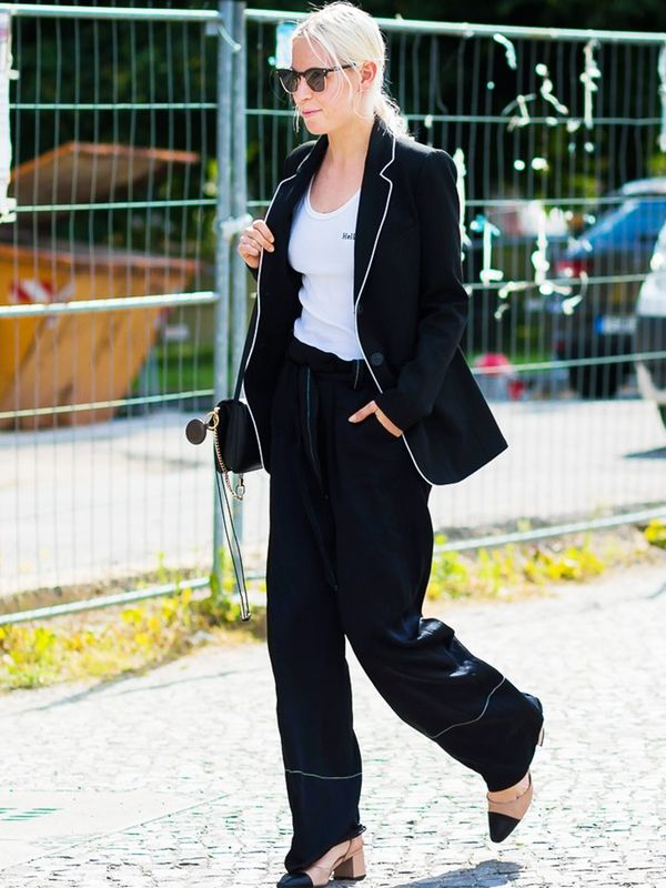 Style Notes:There are two lessons to be learnt here. Firstly, a silky suit looks cool with a white tee. Secondly, ladylike heels are a good option for smartening the louche vibes up.