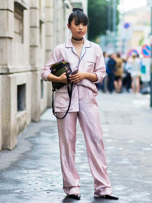 Style Notes: Margaret Zhang has the silk pyjama suit trend wrapped up with a choker on top! The pretty pink fabric benefits from these dark accessories, so it's quite clear she hasn't actually...