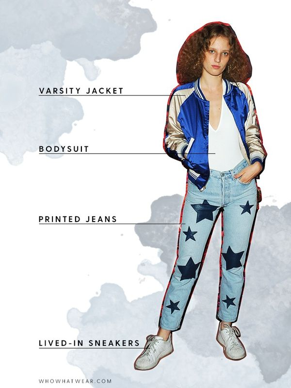 Show your team spirit with a varsity jacket and printed jeans.