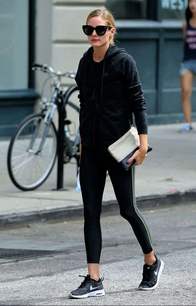 On Olivia Palermo:Perverse Dawn Patrol Sunglasses($45); Nike Zipped Cotton Blend Hoodie($133); Céline Bicolor Solo Pouch($345); Nike Air Max Thea Sneakers($73).