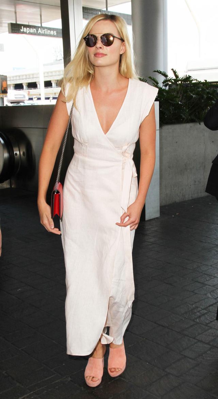 On Margot Robbie:Ray-Ban Double-Bridge Sunglasses($205); Reformation Parisa Dress($218); Gucci XL Mini Bag($1400); Mansur Gavriel mules.