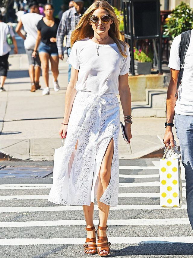 Style Notes: A pitch-perfect white T-shirt get-up we can all get on board with. OP's bangle stack, strappy sandals and statement sunglasses give a simple pairing some extra fashion kudos.