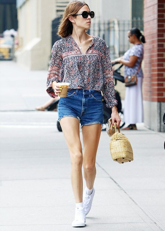 Style Notes: Proving that vintage Levi cut-offs can be worn a million-and-one ways, Alexa's boho blouse–and-trainers combination isn't one we'd automatically think of, but it works....