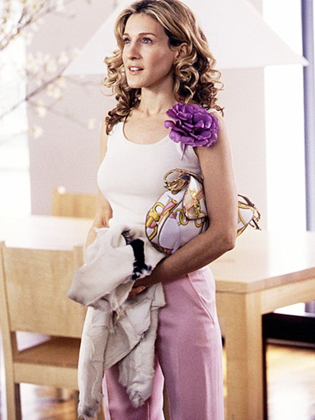 Carrie Bradshaw with her trusty Dior Saddle Bag and a floral corsage, naturally.