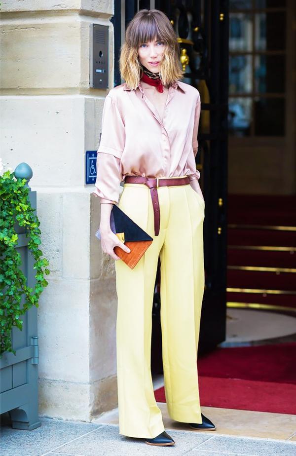 Pink silk top yellow pants street style