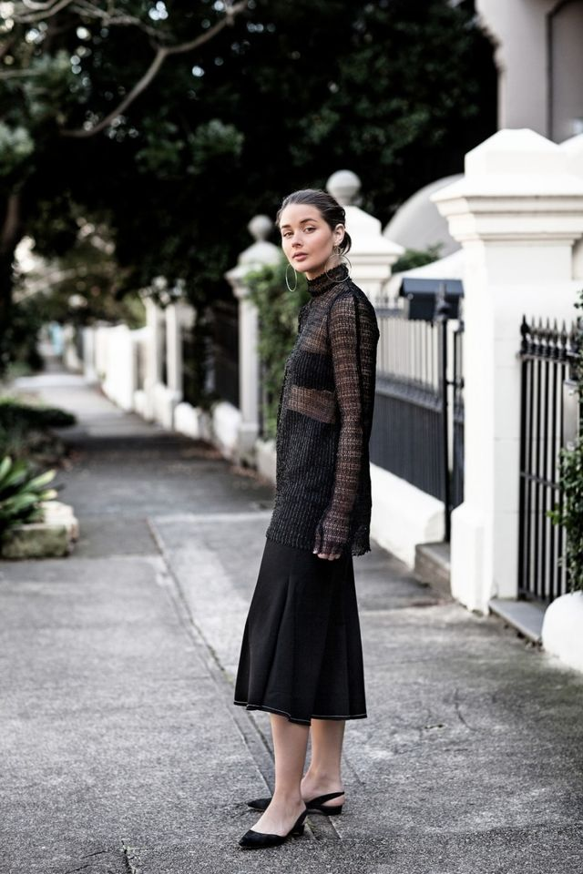 Sara Donaldson wears a cropped version of the trend—perfect for layering under a mesh top.