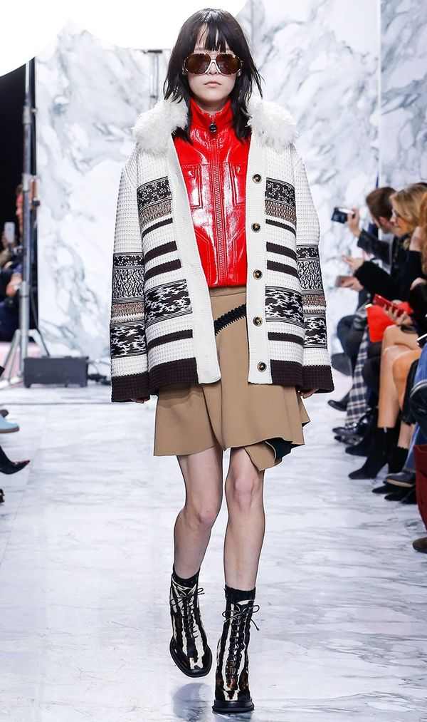 Carven styled its catwalk cardigan with a patent leather top and miniskirt—très bien.