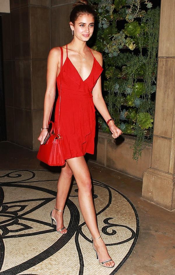 On Taylor Hill: Kimchi Blue Sabina Ruffle Wrap Mini Dress ($49); Saint Laurent Classic Nano Sac de Jour Bag in Lipstick Red Leather ($1990).
