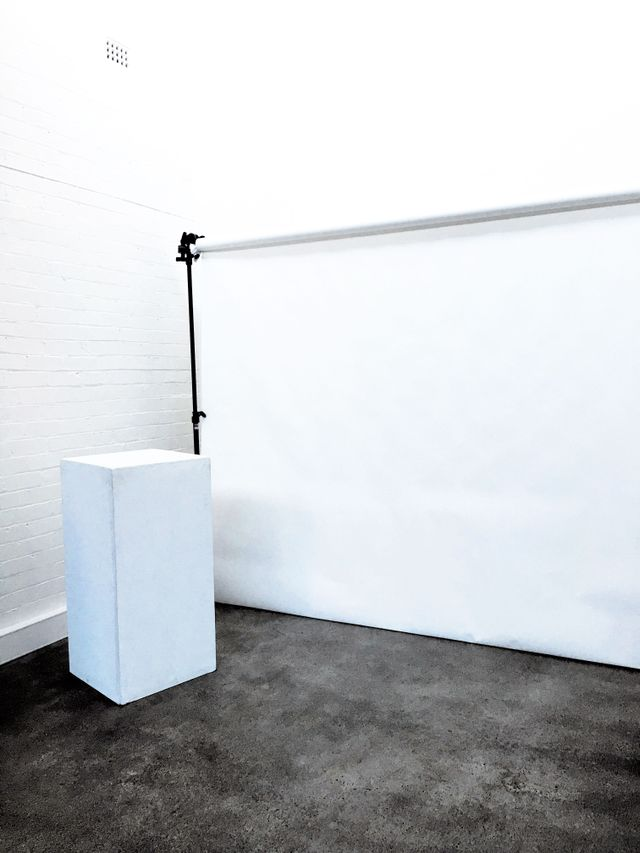 Props (in this case, a white stand) and a drop sheet are set up, ready for the model to arrive on set. The UNDONE keeps its canvas very much in-line with its vibe—effortlessly minimal.
