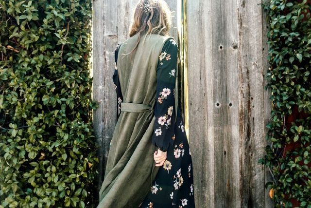 """Pictured: Who What Wear Sleeveless Trench Vest($50) """"A sleeveless trench is a fall must-have. It's a perfect layering piece, and it adds a cool utility look to your outfits and a..."""
