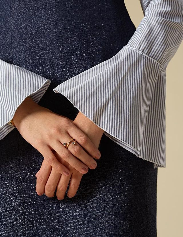 Add forward-feeling yet minimal jewelry for an added touch to keep your look edgy but still keep the focus on the sleeves.