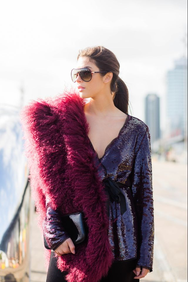 On Jaime Ridge: Harman Grubisa fur stole, sequin blazer, silk pants, Louis Vuitton clutch, Tom Ford sunglasses, Dept. of Finery Heels.