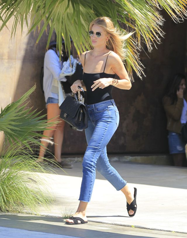 Rosie wore the ultimate off-duty look for 2016, styling a bodysuit and cutoff jeans with casual slides. Swap out her sandals for heels to take the day from to night. On Rosie...