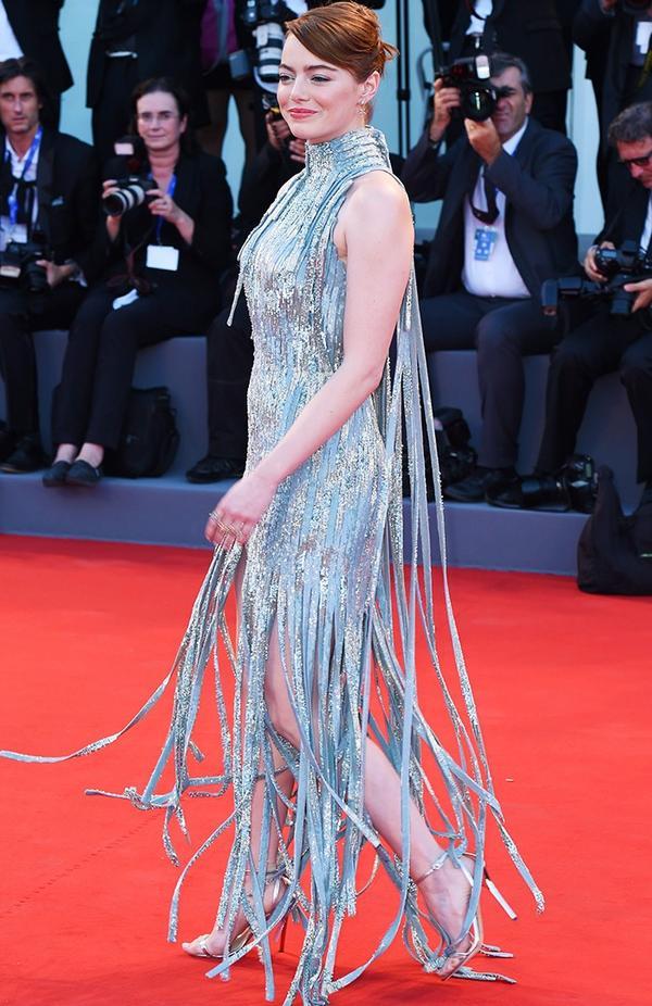 WHO:Emma Stone WEAR:Versace dress; Jimmy Choo shoes.