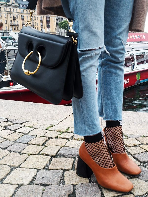 """""""Still not over fishnet socks. I teamed them with chunky heels and Re/Donejeans for the first day of shows."""""""