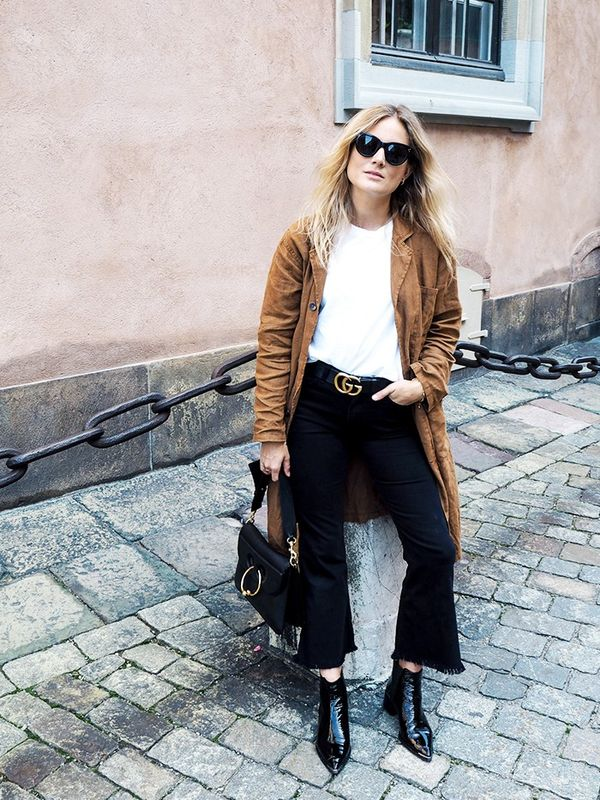 """""""Keeping it neutral and boyish in Mangojeans and Acne boots with the odd flash of gold for the final day of shows."""""""