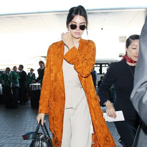 Kendall Jenner in a printed orange coat