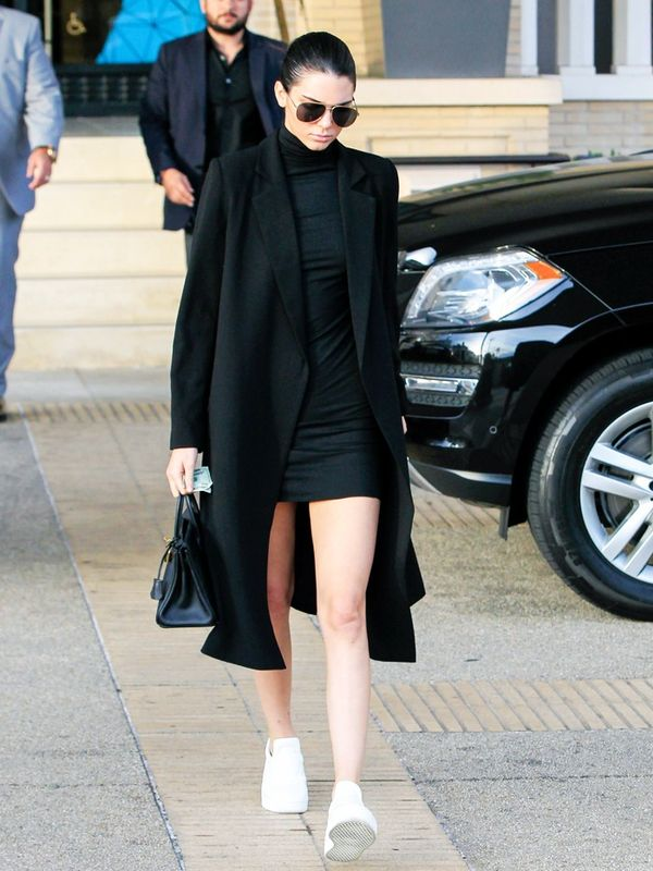 Kendall Jenner wears a classic black coat