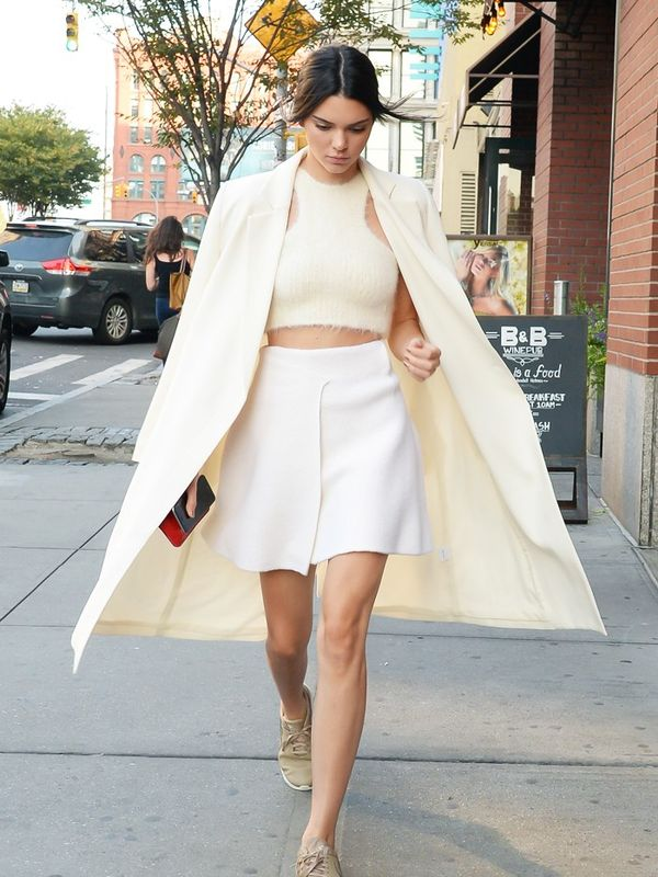 Kendall Jenner wearing a white coat