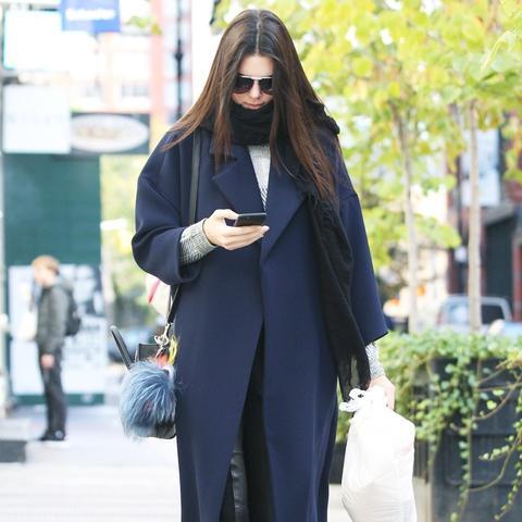 Kendall Jenner wears a navy coat
