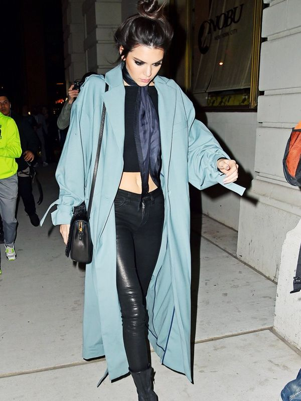 Kendall Jenner in a blue duster coat.