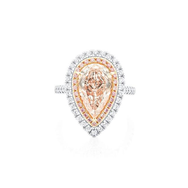 Leibish & Co Fancy Light Orange Pear Shape Halo Ring