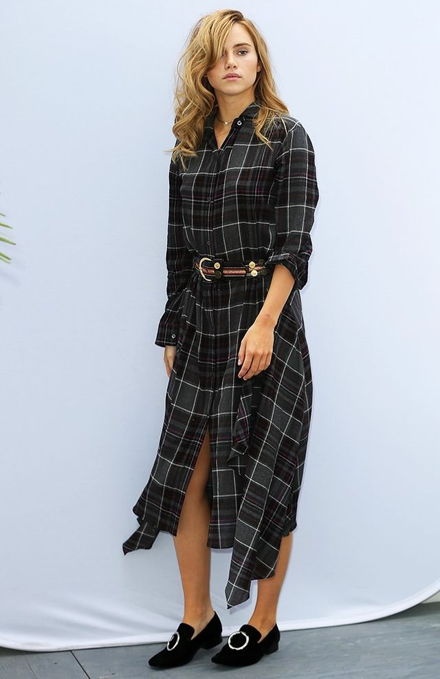 On Suki Waterhouse: Public School Long Sleeve Plaid Shirtdress ($795); Dorateymur Harput Silver Ring Velvet Flats ($480).