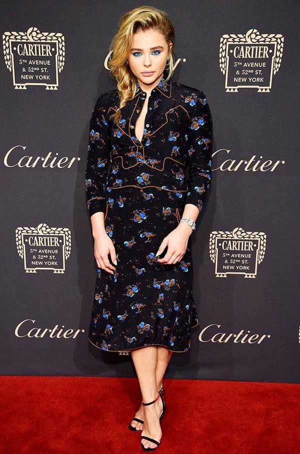WHO:Chloë Grace Moretz WHAT:Cartier Fifth Avenue grand reopening event WEAR: Coach dress; Cartierjewels.