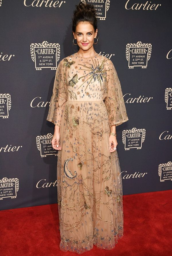 WHO:Katie Holmes WHAT:Cartier Fifth Avenue grand reopening event WEAR: Valentino gown; Cartier jewels.