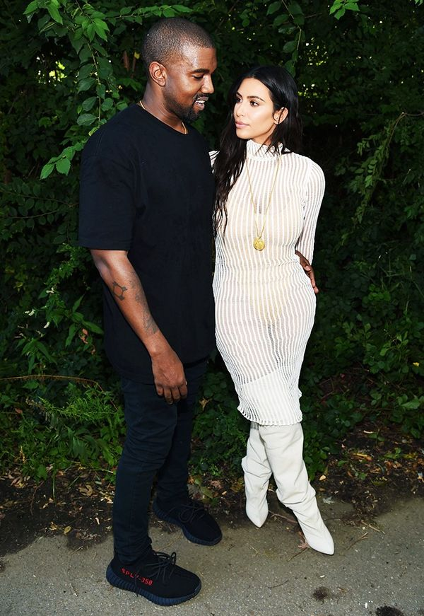 WHO:Kanye West and Kim Kardashian West WHAT:Kanye West Yeezy Season 4 WEAR: Yeezy Season 4 dress and boots.