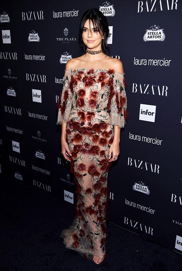 WHO: Kendall Jenner WHAT:Harper's Bazaar Icons Party WEAR:Marchesadress;Stuart Weitzman Sabbia Beige Patent Nudist Sandals ($415).