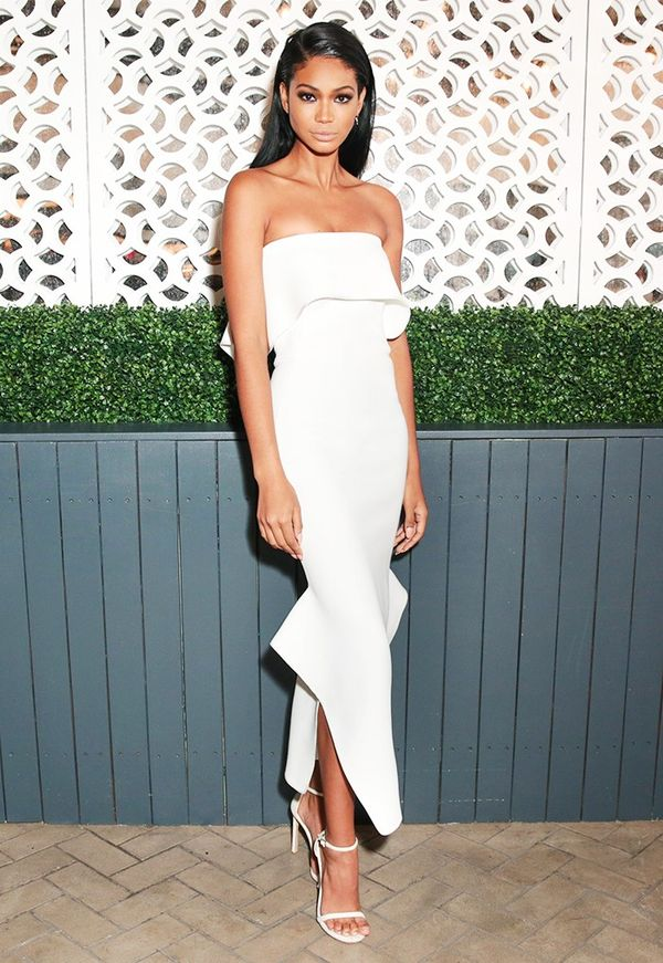 WHO: Chanel Iman WHAT: Vogue x Stuart Weitzman party WEAR: Maticevski Resort 2017 Strapless Peplum Ivory Midi Dress.