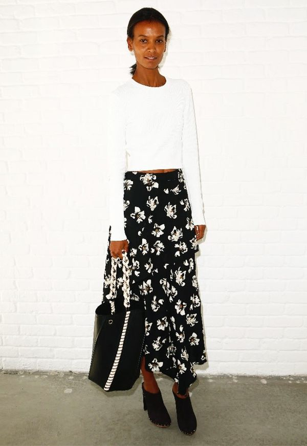 WHO: Liya Kebede  WHAT: Proenza Schouler S/S17 show WEAR: Proenza Schouler white crew neck knit, flower skirt, and suede boots from the Pre Fall 2016 collection...