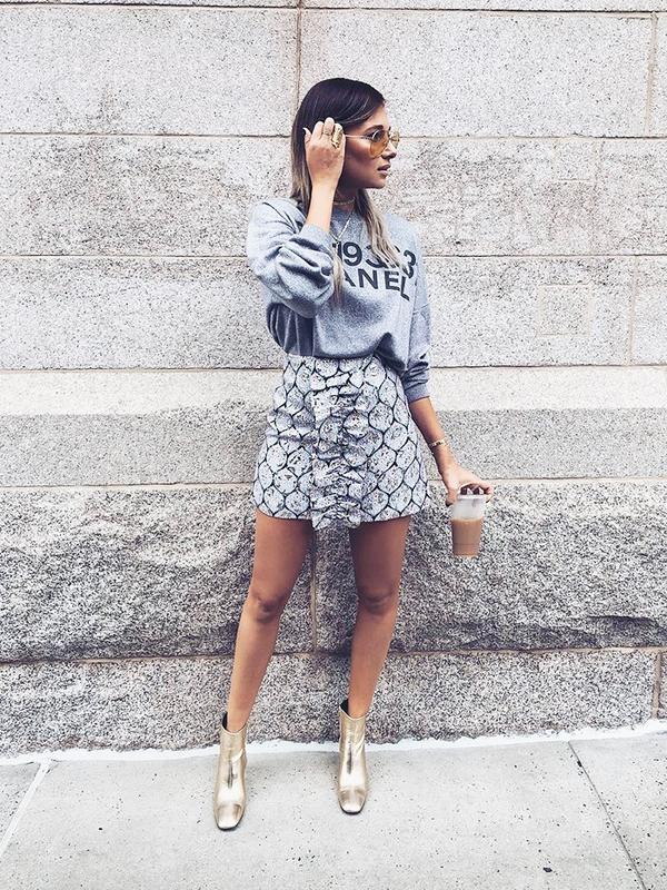 On Danielle Bernstein: Suno Patterned Ruffle Mini Skirt ($695); Anine Bing boots.