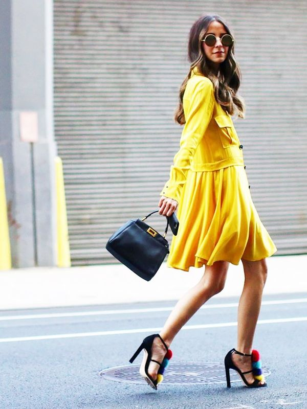 On Arielle Charnas: Marissa Webb Elise Dress($315); Brian Atwood shoes; Sunday Somewhere Ned Sunglasses($290); Fendi Peekaboo Medium Satchel Bag($3950).