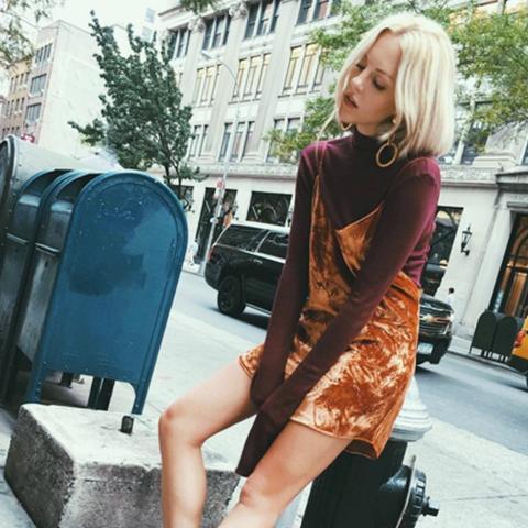 how to wear a slip dress in autumn winter:  Shea Marie in a velvet slip dress