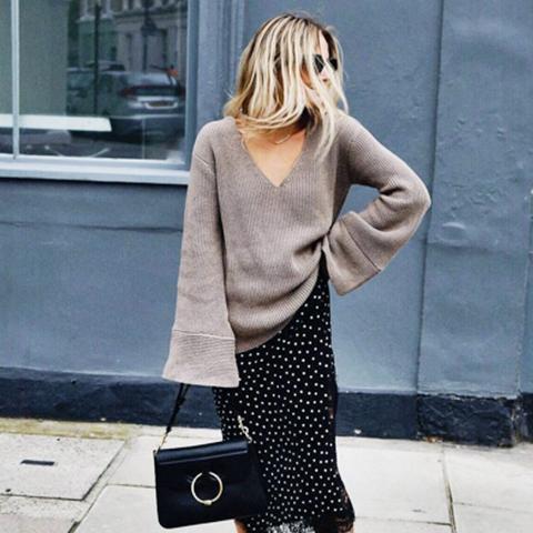 how to wear a slip dress in autumn winter: Lucy Williams wears a slip dress under her knitwear